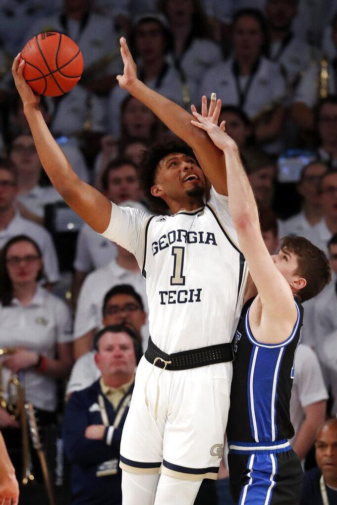 Georgia Tech forward James Banks III (1) takes a shot as Duke forward Joey Baker (13) defends in the first half of an NCAA college basketball game Wednesday, Jan. 8, 2020, in Atlanta. (AP Photo/John Bazemore)