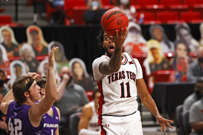 Texas Tech's Kyler Edwards (11) lays up the ball during the second half of the team's NCAA college basketball game against Abilene Christian, Wednesday, Dec. 9, 2020, in Lubbock, Texas. (AP Photo/Brad Tollefson)