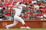 St. Louis Cardinals' Tommy Edman watches his two-run double during the second inning of a baseball game against the Colorado Rockies, Sunday, Aug. 25, 2019, in St. Louis. (AP Photo/Jeff Roberson)