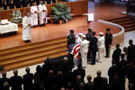A military honor guard escorts the casket of Sen. Richard Lugar during a funeral service, Wednesday, May 15, 2019, in Indianapolis. Lugar was a longtime Republican senator and former Indianapolis mayor who's been hailed as an