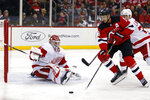 Detroit Red Wings goaltender Jonathan Bernier defends against New Jersey Devils center Travis Zajac during the second period of an NHL hockey game Saturday, Nov. 17, 2018, in Newark, N.J. (AP Photo/Adam Hunger)