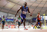 Noah Lyles of the United States leads the team to gold in the men's 4x100 meter relay final at the World Athletics Championships in Doha, Qatar, Saturday, Oct. 5, 2019. (AP Photo/Petr David Josek)