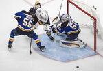 St. Louis Blues' goalie Jordan Binnington (50) makes the save on Vegas Golden Knights Tomas Nosek (92) as Colton Parayko (55) defendsduring the second period of an NHL hockey playoff game Thursday, Aug. 6, 2020, in Edmonton, Alberta. (Jason Franson/Canadian Press via AP)