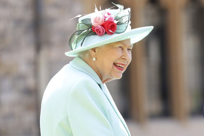 """FILE - In this July 17, 2020 file photo, Britain's Queen Elizabeth smiles after awarding Captain Sir Thomas Moore his knighthood during a ceremony at Windsor Castle in Windsor, England. The former British colony of Barbador, once known as """"Little England,"""" announced Tuesday, Sept. 15, that it plans to replace the monarch with its own head of state in time for next year's 55th independence anniversary. (AP Photo/Chris Jackson, File)"""