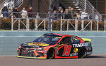 Martin Truex Jr. drives on the front stretch during a NASCAR Cup Series auto race on Sunday, Nov. 17, 2019, at Homestead-Miami Speedway in Homestead, Fla. Truex is one of four drivers running for the championship. (AP Photo/Terry Renna)