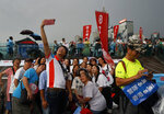 FILE - In this July 20, 2019, file photo, pro-China supporters pose for a picture during a counter-rally in support of the police in Hong Kong. Twitter said Monday it has suspended more than 200,000 accounts it believes were linked to the Chinese government and a disinformation campaign targeting the protests in Hong Kong. (AP Photo/Vincent Yu, File)