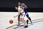 Hartford's D.J. Mitchell dribbles the ball under pressure from Villanova's Justin Moore, right, in the first half of an NCAA college basketball game, Tuesday, Dec. 1, 2020, in Uncasville, Conn. (AP Photo/Jessica Hill)