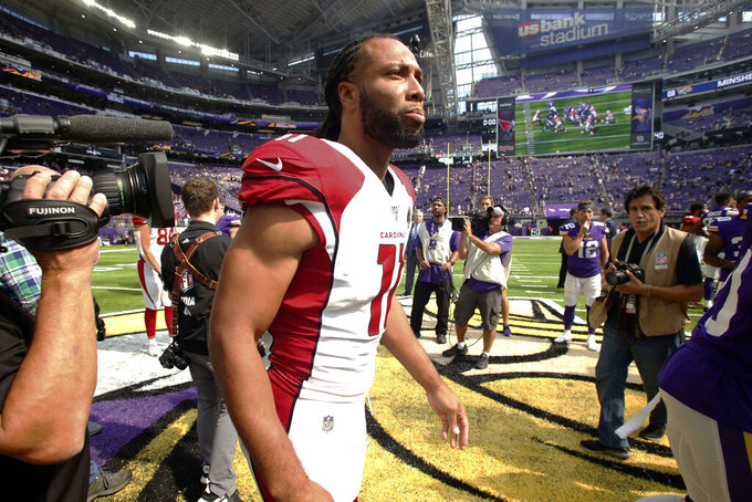Arizona Cardinals wide receiver Larry Fitzgerald walks off the field after an NFL preseason football game against the Minnesota Vikings, Saturday, Aug. 24, 2019, in Minneapolis. The Vikings won 20-9. (AP Photo/Bruce Kluckhohn)
