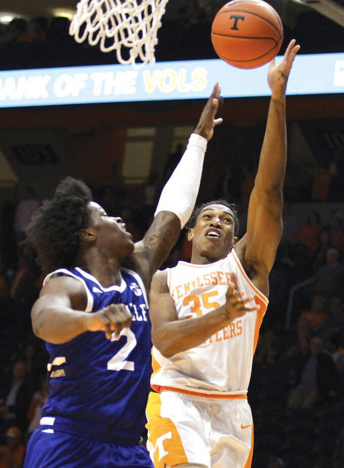 Tennessee's Yves Pons (35) drives for a layup defended by UNC Asheville's LJ Thorpe during an NCAA college basketball game Tuesday, Nov. 5, 2019, in Knoxville, Tenn. (Tom Sherlin/The Daily Times via AP)