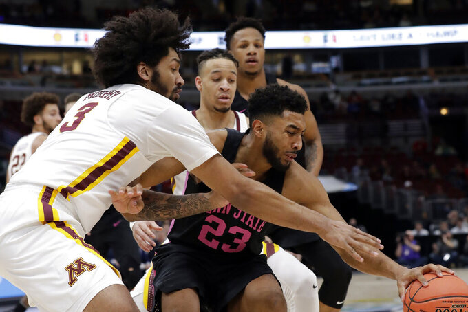 Penn State's Josh Reaves (23) battles for a loose ball against Minnesota's Jordan Murphy (3) during the first half of an NCAA college basketball game in the second round of the Big Ten Conference tournament, Thursday, March 14, 2019, in Chicago. (AP Photo/Nam Y. Huh)