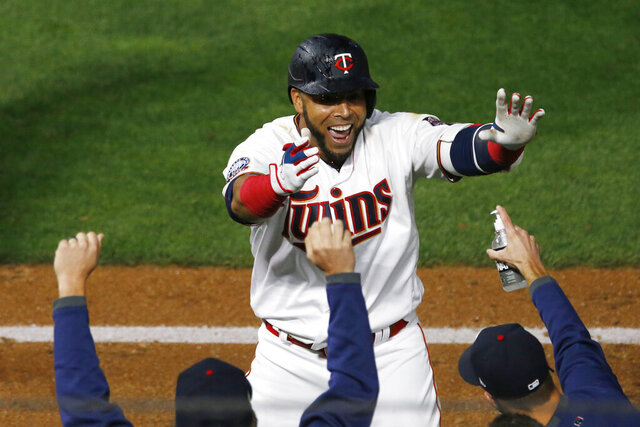 Minnesota Twins' Nelson Cruz celebrates his game-winning RBI off Pittsburgh Pirates pitcher Nick Burdi in the ninth inning of a baseball game Monday, Aug. 3, 2020, in Minneapolis. The Twins won 5-4. (AP Photo/Jim Mone)