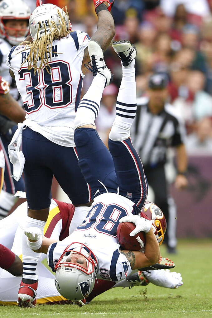 New England Patriots wide receiver Gunner Olszewski (80) falls to the turf against the Washington Redskins during the first half of an NFL football game, Sunday, Oct. 6, 2019, in Washington. (AP Photo/Nick Wass)
