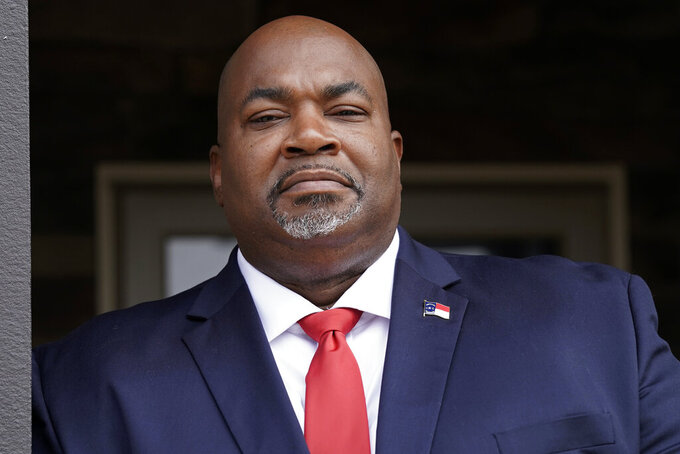 """North Carolina Lt. Gov. Mark Robinson is shown at his home in Colfax, N.C., Tuesday, Nov. 10, 2020. Robinson announced late Monday, April 19, 2021 he will not seek the Republican U.S. Senate nomination in 2022. Robinson, who was elected five months ago to the state's No. 2 executive position in his first run for elected office, said in a video last week he was taking a """"serious look"""" at a bid to succeed retiring Sen. Richard Burr. (AP Photo/Gerry Broome, file)"""