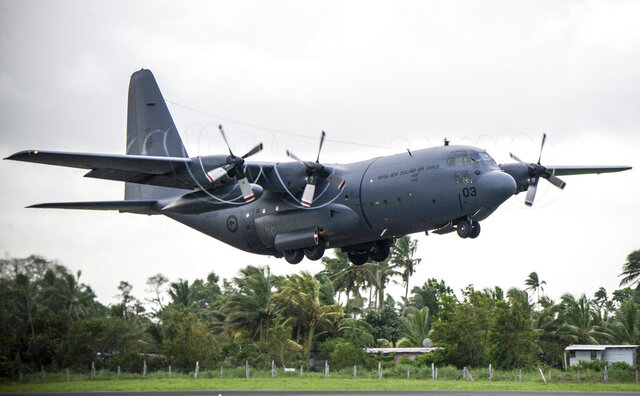 A RNZAF C-130 Hercules takes off from Nausori Airport, having just delivered aid and cargo in support of the relief effort following Tropical Cyclone Winston in Fiji on Feb. 27, 2016. New Zealand's military said Friday, June 5, 2020, it will buy five Super Hercules transport planes from Lockheed Martin for $1 billion. (Sgt. Sam Shepherd/NZDF via AP)