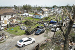 Residents cleans up in a tornado damaged neighborhood, Wednesday, May 29, 2019, in Dayton, Ohio. Tens of thousands of Ohio residents were still without power or water in the aftermath of strong tornadoes that spun through the Midwest earlier in the week. (AP Photo/John Minchillo)