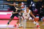 Indiana's Khristian Lander (4) is defended by Purdue's Eric Hunter Jr. (2) during the first half of an NCAA college basketball game Thursday, Jan. 14, 2021, in Bloomington Ind. (AP Photo/Darron Cummings)