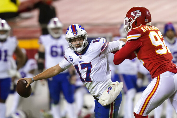 Buffalo Bills quarterback Josh Allen (17) is sacked by Kansas City Chiefs defensive end Tanoh Kpassagnon, right, during the second half of the AFC championship NFL football game, Sunday, Jan. 24, 2021, in Kansas City, Mo. (AP Photo/Orlin Wagner)