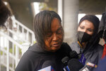 Dawn Saddler, sister of missing crewmember Gregory Walcott, talks to reporters as she leaves a briefing for family members by Coast Guard and NTSB officials in Port Fouchon, La., Friday, April 16, 2021. The Coast Guard has told families of missing workers that another body has been found from the lift boat capsized off the Louisiana coast and a coroner has confirmed that to a news outlet.  (AP Photo/Gerald Herbert)