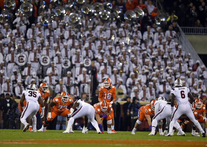 Clemson's Trevor Lawrence (16) waits for the snap during the first half of an NCAA college football game against South Carolina Saturday, Nov. 24, 2018, in Clemson, S.C. (AP Photo/Richard Shiro)