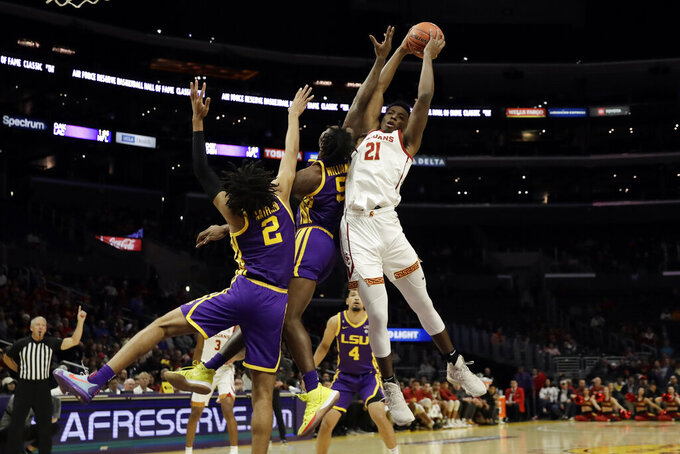 Southern California forward Onyeka Okongwu (21) grabs a rebound against LSU during the first half of an NCAA college basketball game Saturday, Dec. 21, 2019, in Los Angeles. (AP Photo/Marcio Jose Sanchez)
