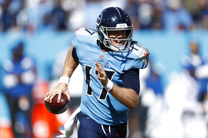 Tennessee Titans quarterback Ryan Tannehill scrambles against the Indianapolis Colts in the second half of an NFL football game Sunday, Sept. 26, 2021, in Nashville, Tenn. (AP Photo/Wade Payne)