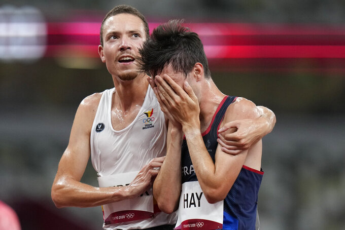 Robin Hendrix, of Belgium, left, embraces Hugo Hay, of France, after their men's 5,000-meters at the 2020 Summer Olympics, Tuesday, Aug. 3, 2021, in Tokyo. (AP Photo/Petr David Josek)
