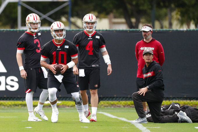 San Francisco 49ers quarterbacks C.J. Beathard (3) and quarterback Nick Mullens (4) wait their turn as Jimmy Garoppolo (10) throws during practice, Wednesday, Jan. 29, 2020, in Coral Gables, Fla., for the NFL Super Bowl 54 football game. (AP Photo/Wilfredo Lee)