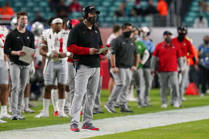 Ohio State head coach Ryan Day watches his team during the first half of an NCAA College Football Playoff national championship game against Alabama, Monday, Jan. 11, 2021, in Miami Gardens, Fla. (AP Photo/Lynne Sladky)