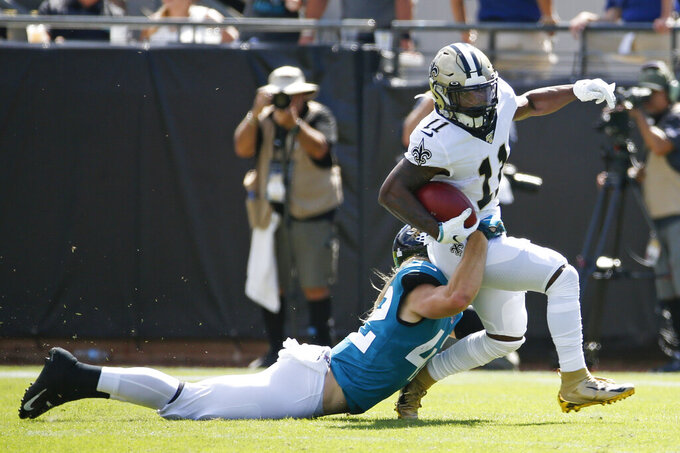 New Orleans Saints wide receiver Deonte Harris (11) is brought down by Jacksonville Jaguars defensive back Andrew Wingard, left, during the first half of an NFL football game, Sunday, Oct. 13, 2019, in Jacksonville, Fla. (AP Photo/Stephen B. Morton)