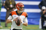 Cincinnati Bengals quarterback Joe Burrow (9) looks to throw during the first half of an NFL football game against the Indianapolis Colts, Sunday, Oct. 18, 2020, in Indianapolis. (AP Photo/Michael Conroy)