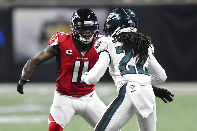 Atlanta Falcons wide receiver Julio Jones (11) blocks Philadelphia Eagles cornerback Sidney Jones (22) during the first half of an NFL football game, Sunday, Sept. 15, 2019, in Atlanta. (AP Photo/Mike Stewart)