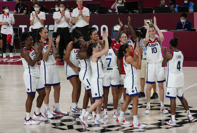 United States players celebrate their win in the women's basketball gold medal game against Japan at the 2020 Summer Olympics, Sunday, Aug. 8, 2021, in Saitama, Japan. (AP Photo/Luca Bruno)