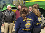 Vice President Mike Pence, left, visits with farmers and future farmers as he tours the R & J Johnson Farms in Glyndon, Minn., Thursday, May 9, 2019, to talk about the Trump administration's trade agreement with Canada and Mexico. Famers who met with Pence emphasized the importance of selling soy beans as Minnesota ranks third among all states in soy bean production. (AP Photo/Dave Kolpack)