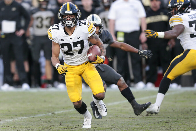 Iowa defensive back Amani Hooker (27) runs with the ball after intercepting it while playing Purdue in the second half of an NCAA college football game in West Lafayette, Ind., Saturday, Nov. 3, 2018. (AP Photo/AJ Mast)