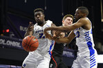 Hofstra forward Isaac Kante, left, and guard Jalen Ray, right, vie or the ball against Northeastern guard Bolden Brace, center, during the first half of an NCAA college basketball game for the championship of the Colonial Athletic Association men's tournament Tuesday, March 10, 2020, in Washington. (AP Photo/Nick Wass)