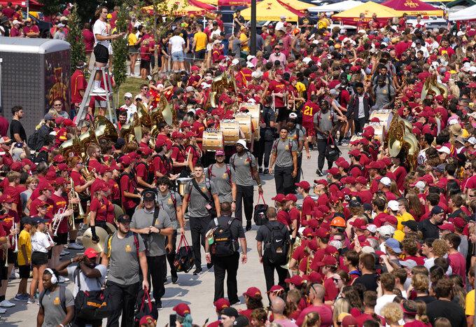 The Iowa State team greets fans along the spirit walk before an NCAA college football game against Iowa, Saturday, Sept. 11, 2021, in Ames, Iowa. (AP Photo/Matthew Putney)