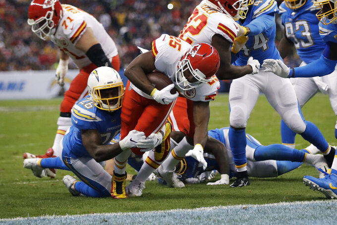 Kansas City Chiefs running back LeSean McCoy, center, scores a touchdown during the first half of an NFL football game against the Los Angeles Chargers, Monday, Nov. 18, 2019, in Mexico City. (AP Photo/Marcio Jose Sanchez)