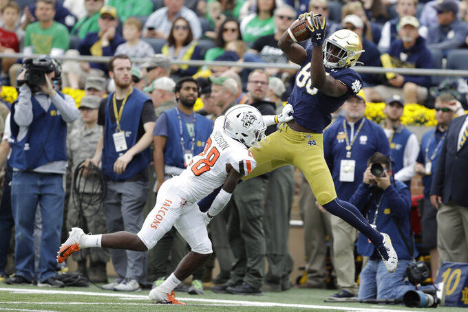 Notre Dame wide receiver Javon McKinley (88) makes a catch against Bowling Green defensive back JaJuan Hudson (28) during the first half of an NCAA college football game, Saturday, Oct. 5, 2019, in South Bend, Ind. (AP Photo/Darron Cummings)