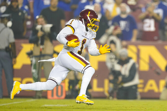 Washington Football Team wide receiver DeAndre Carter (1) running with the ball during the first half of an NFL football game, Thursday, Sept. 16, 2021, in Landover, Md. (AP Photo/Patrick Semansky)