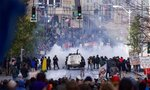FILE - In this Nov. 30 1999, file photo, Seattle police use tear gas to push back World Trade Organization protesters in downtown Seattle.   Saturday, Nov. 30, 2019 marks 20 years since tens of thousands of protesters converged on Seattle and disrupted a major meeting of the World Trade Organization. The protesters' message was amplified not just by their vast numbers but by the response of overwhelmed police, who fired tear gas and plastic bullets and arrested nearly 600 people. Two decades later, many of their causes are still relevant. (AP Photo/Eric Draper, File)