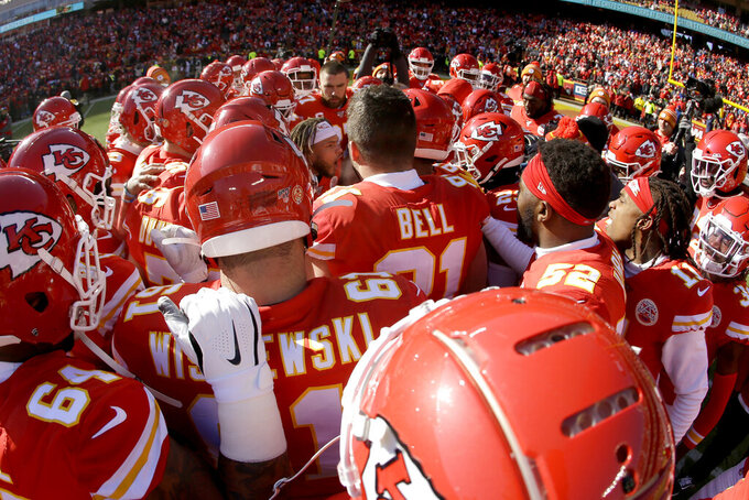 The Kansas City Chiefs huddles around safety Tyrann Mathieu before the NFL AFC Championship football game against the Tennessee Titans Sunday, Jan. 19, 2020, in Kansas City, MO. (AP Photo/Charlie Riedel)