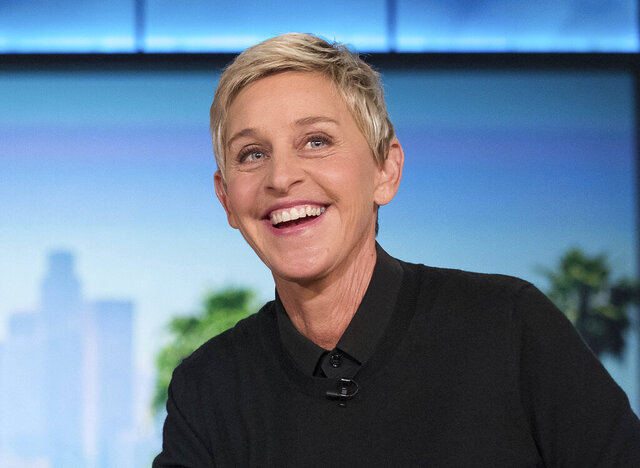 FILE - In this Oct. 13, 2016, file photo, Ellen DeGeneres appears during a commercial break at a taping of