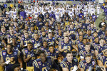 Navy players sing their alma mater as Kansas State players, top, stand and listen before leaving the field after the Liberty Bowl NCAA college football game Tuesday, Dec. 31, 2019, in Memphis, Tenn. Navy won 20-17. (AP Photo/Mark Humphrey)