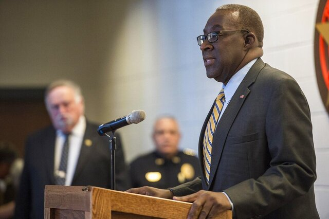 FILE- In this March 23, 2016 file photo, U.S. Attorney Ed Tarver addresses a news conference in Savannah, Ga.  The former federal prosecutor who served under President Barack Obama says he plans to run for the seat of newly sworn-in Republican Sen. Kelly Loeffler of Georgia.  Tarver of Augusta confirmed Friday, Jan. 10, 2020 that he plans to announce soon his campaign for the seat vacated by GOP Sen. Johnny Isakson. (Josh Galemore/Savannah Morning News via AP)
