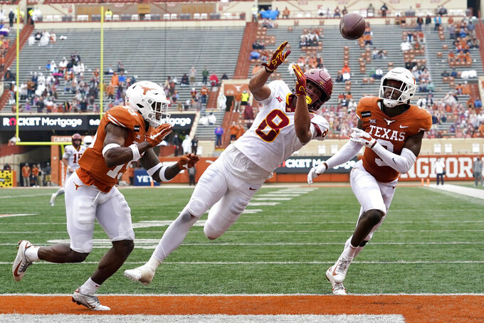 Iowa State wide receiver Xavier Hutchinson (8) fails to make a catch in the end zone as Texas defensive backs Chris Brown, left, and Jalen Green, right, defend during the first half of an NCAA college football game, Friday, Nov. 27, 2020, in Austin, Texas. (AP Photo/Eric Gay)
