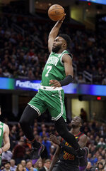 Boston Celtics' Jaylen Brown (7) drives to the basket against Cleveland Cavaliers' Deng Adel (32) during the first half of an NBA basketball game Tuesday, Feb. 5, 2019, in Cleveland. (AP Photo/Tony Dejak)
