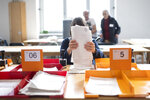Volunteers are helping to count the voting documents for the Swiss national elections, on Sunday, Oct.20, 2019, in Zurich, Switzerland. (Ennio Leanza/Keystone via AP)