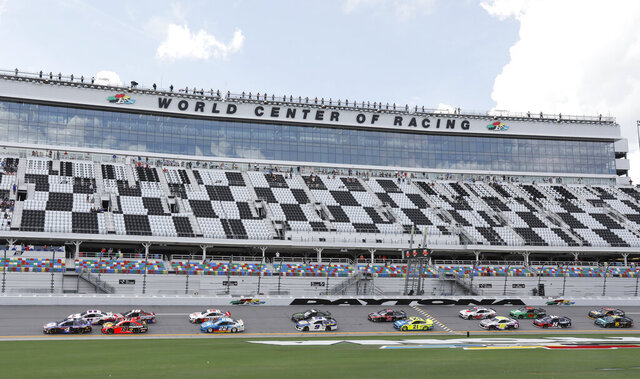 Kevin Harvick leads the field to start the NASCAR Cup Series auto race at Daytona International Speedway, Sunday, Aug. 16, 2020, in Daytona Beach, Fla. (AP Photo/Terry Renna)