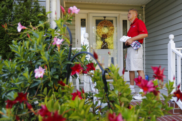 Virginia House of Delegates Speaker, Kirk Cox, R-Colonial Heights, waits for the door to be answered as he canvasses a neighborhood in Petersburg, Va., Monday, Sept. 23, 2019. Cox is facing Democratic challenger Shelia Bynum-Coleman in the November election. (AP Photo/Steve Helber)