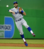 Los Angeles Dodgers shortstop Chris Taylor throws to first to put out Miami Marlins' Bryan Holaday in the third inning of a baseball game, Thursday, May 17, 2018, in Miami. (AP Photo/Wilfredo Lee)